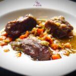 Comida a domicilio - Carrilleras de cerdo con salsa de verduras al vino tinto